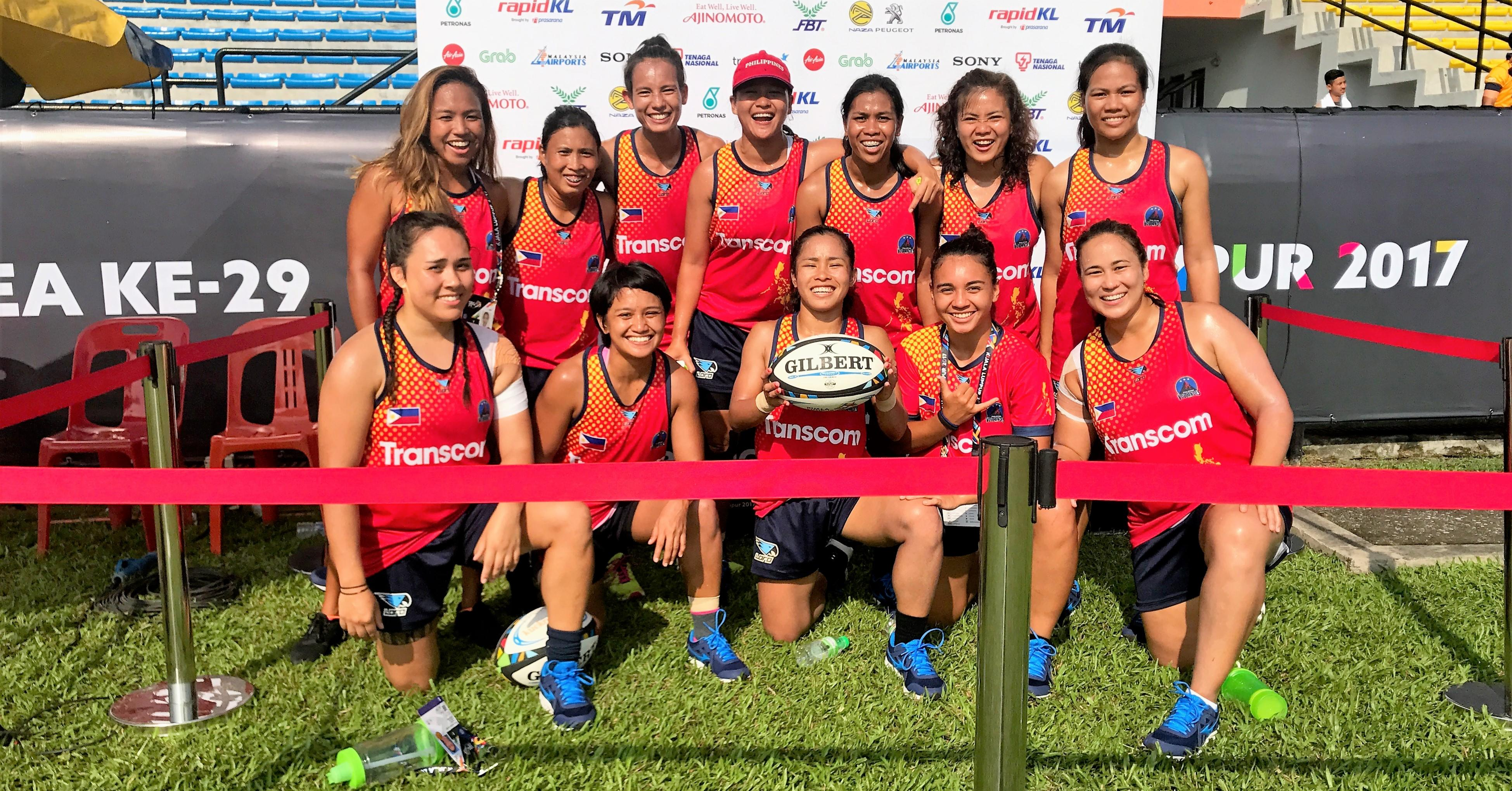 Ada Milby (far right) with fellow players in The Philippines national women's rugby team