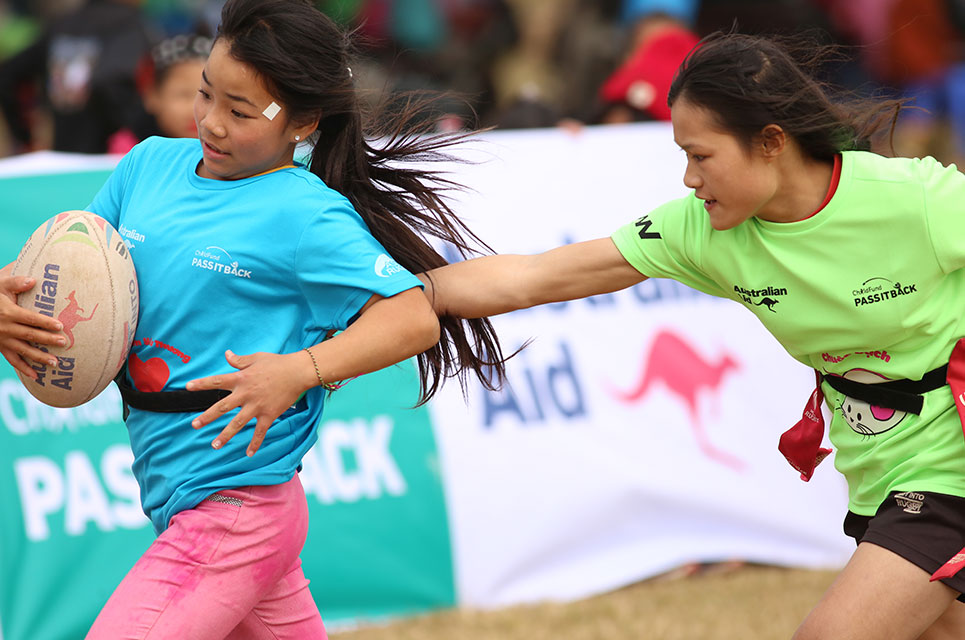 Girls in Vietnam playing tag rugby