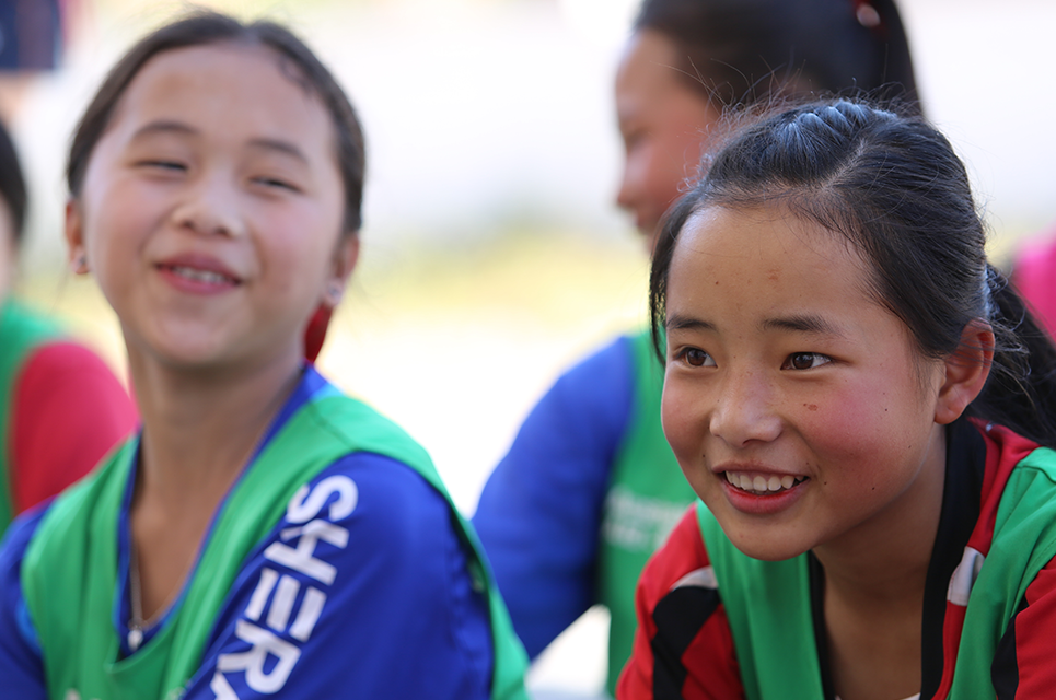 ChildFund Pass It Back female players in Laos